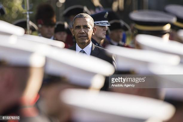 President Barack Obama with Italian Prime Minister Matteo Renzi walk past US Navy Sailors in the Honor Guard during a Pass and Review of the...