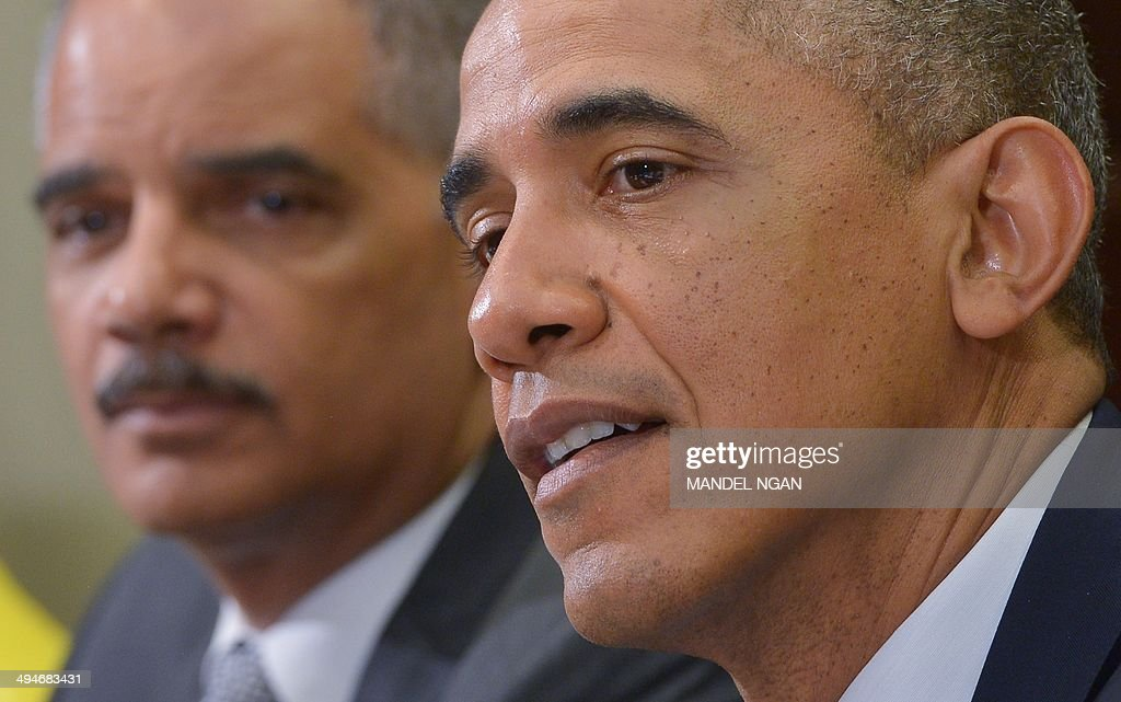 US President Barack Obama (R), with US Attorney General Eric, Holder speaks following a meeting with the My Brothers Keeper Task Force in the Roosevelt Room of the White House on May 30, 2014 in Washington, DC. President Obama launched 'My Brothers Keeper' to help empower boys and young men of color, AFP PHOTO/Mandel NGAN