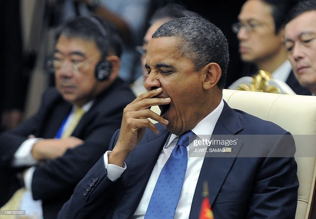US President Barack Obama yawns as he attends an East Asian Summit Plenary Session at the Peace Palace in Phnom Penh on November 20, 2012. During the two-day East Asia Summit, Obama was scheduled to hold talks with the leaders of the 10-member Association of Southeast Asian Nations (ASEAN) along with Chinese Premier Wen Jiabao and Japan's Premier Yoshihiko Noda. AFP PHOTO Jewel Samad