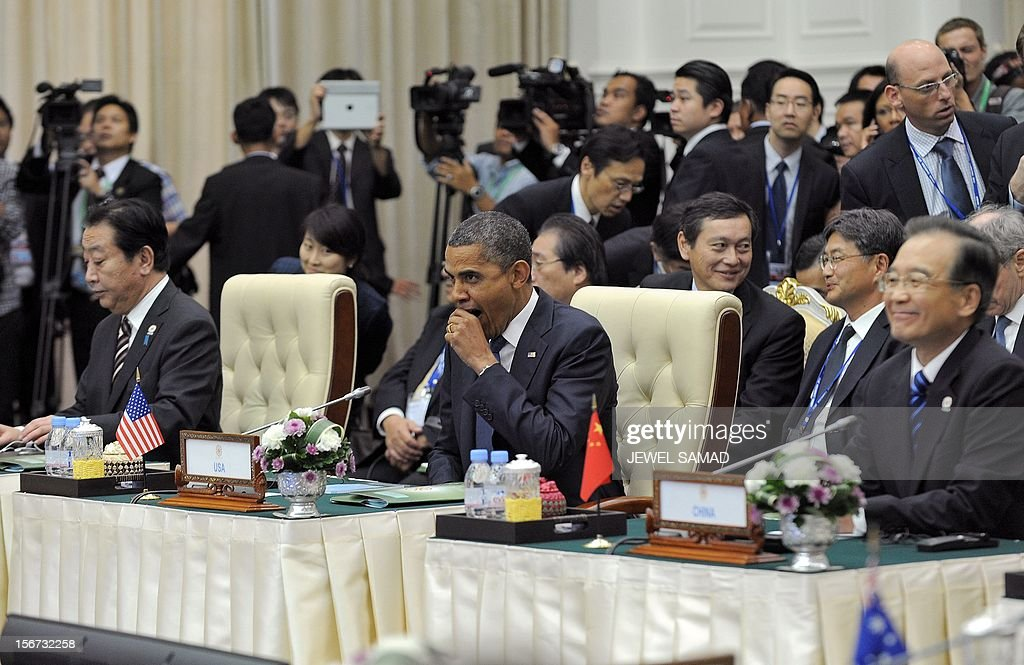 US President Barack Obama (C) yawns as he attends an East Asian Summit Plenary Session with Chinese Premier Wen Jiabao (R) and Japanese Prime Minister Yoshihiko Noda (L) along with other leaders at the Peace Palace in Phnom Penh on November 20, 2012. During the two-day East Asia Summit, Obama was scheduled to hold talks with the leaders of the 10-member Association of Southeast Asian Nations (ASEAN) along with Chinese Premier Wen Jiabao and Japan's Premier Yoshihiko Noda. AFP PHOTO Jewel Samad