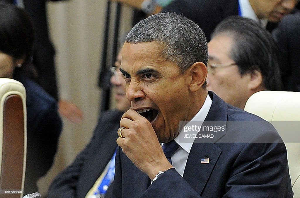 US President Barack Obama yawns as he attends the East Asian Summit Plenary Session at the Peace Palace in Phnom Penh on November 20, 2012. During the two-day East Asia Summit, Obama was scheduled to hold talks with the leaders of the 10-member Association of Southeast Asian Nations (ASEAN) along with Chinese Premier Wen Jiabao and Japan's Premier Yoshihiko Noda. AFP PHOTO Jewel Samad