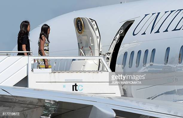 US President Barack Obama's daughters Malia and Sasha board the US Air Force One at Ezeiza airport in Buenos Aires on their way to Bariloche on March...