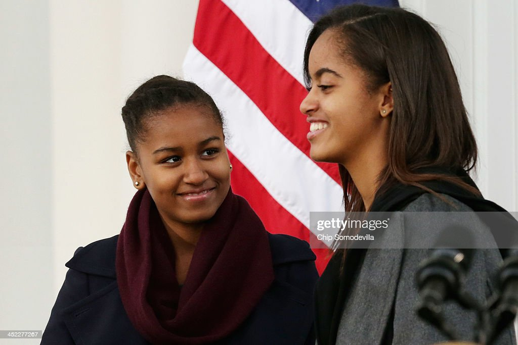 U.S. President Barack Obama's daughters <a gi-track='captionPersonalityLinkClicked' href=/galleries/search?phrase=Malia+Obama&family=editorial&specificpeople=2631620 ng-click='$event.stopPropagation()'>Malia Obama</a> (R), 15, and <a gi-track='captionPersonalityLinkClicked' href=/galleries/search?phrase=Sasha+Obama&family=editorial&specificpeople=2631619 ng-click='$event.stopPropagation()'>Sasha Obama</a>, 12, participate in the pardoning of the 2013 National Thanksgiving Turkey, 'Popcorn' on the North Portico of the White House November 27, 2013 in Washington, DC. A 38-pound, full-grown Broad Breasted White domesticated turkey, 'Popcorn' and its alternate 'Caramel' will be sent to live at Mount Vernon, the estate and home of George Washington.