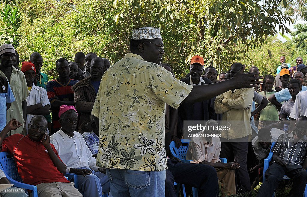 President Barack Obama's Kenyan half brother, Malik Obama adresses his supporters on January 16, 2013 during a campaign rally under a tree near Nyang'oma in Kogelo, now renowned as the Obama's traditional home. Malik has launched his own political career by announcing his intention to run for a Kenyan gubernatorial seat in the upcoming March 4 general elections. Malik, 54, who shares a father with the US president told AFP that the achievements of his more famous half brother have 'inspired and challenged' him to get into active politics in his homeland. The trained economist said he is the right candidate to deal with the 'endless cycle of poverty and unemployment that bedevils my people.' . AFP PHOTO/Tony KARUMBA