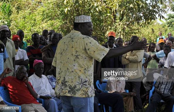 President Barack Obama's Kenyan half brother Malik Obama adresses his supporters on January 16 2013 during a campaign rally under a tree near...