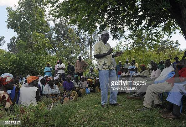 President Barack Obama's Kenyan half brother Malik Obama adresses supporters on January 16 2013 near Nyang'oma in Kogelo now renowned as the Obama's...
