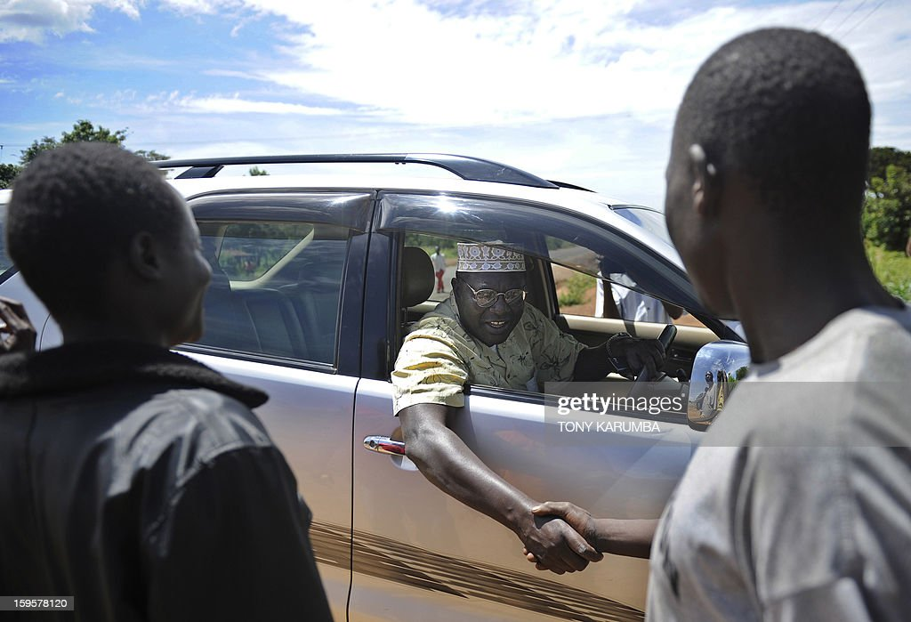 President Barack Obama's Kenyan half brother Malik Obama greets some of his supporters on January 16 2013 during a campaign rally near Nyang'oma in...