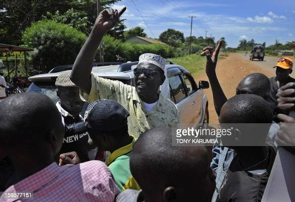 President Barack Obama's Kenyan half brother Malik Obama rallies supporters on January 16 2013 near Nyang'oma in Kogelo now renowned as the Obama's...