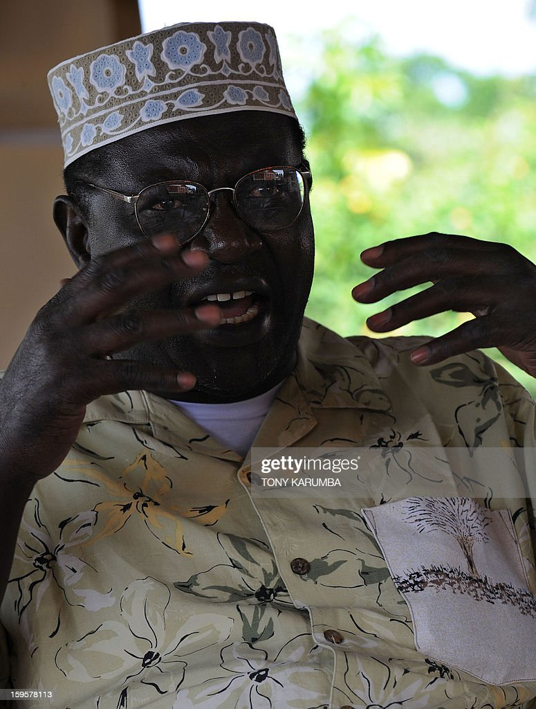 President Barack Obama's Kenyan half brother Malik Obama speaks at an interview January 16 2013 at the peaceful hamlet of Nyang'oma in Kogelo...
