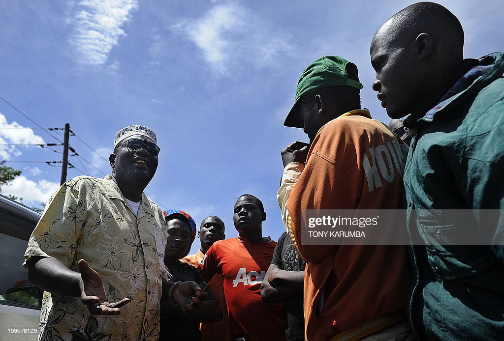 President Barack Obama's Kenyan half brother, Malik Obama (L) talks with some of his supporters on January 16, 2013 during a campaign rally near Nyang'oma in Kogelo, now renowned as the Obama's traditional home. Malik has launched his own political career by announcing his intention to run for a Kenyan gubernatorial seat in the upcoming March 4 general elections. Malik, 54, who shares a father with the US president told AFP that the achievements of his more famous half brother have 'inspired and challenged' him to get into active politics in his homeland. The trained economist said he is the right candidate to deal with the 'endless cycle of poverty and unemployment that bedevils my people.' . AFP PHOTO/Tony KARUMBA