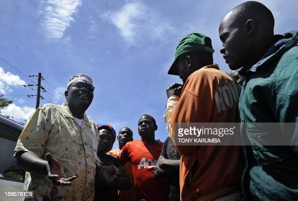 President Barack Obama's Kenyan half brother Malik Obama talks with some of his supporters on January 16 2013 during a campaign rally near Nyang'oma...