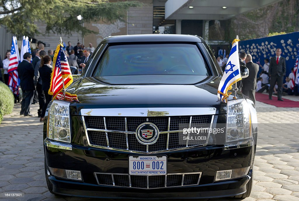 US President Barack Obama's limousine, known as the 'Beast,' is seen with American and Israeli flags outside of the President's Residence as Obama meets with Israeli President Shimon Peres in Jerusalem, March 20, 2013, on the first day of Obama's three day trip to Israel. AFP PHOTO / Saul LOEB