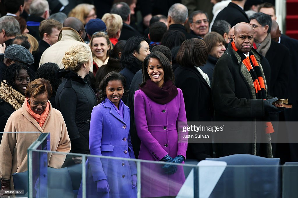U.S. President Barack Obama's mother-in-law Marian Robinson, daughters, Sasha Obama and Malia Obama, Mrs. Obama's brother Craig Robinson arrive during the presidential inauguration on the West Front of the U.S. Capitol January 21, 2013 in Washington, DC. Barack Obama was re-elected for a second term as President of the United States.