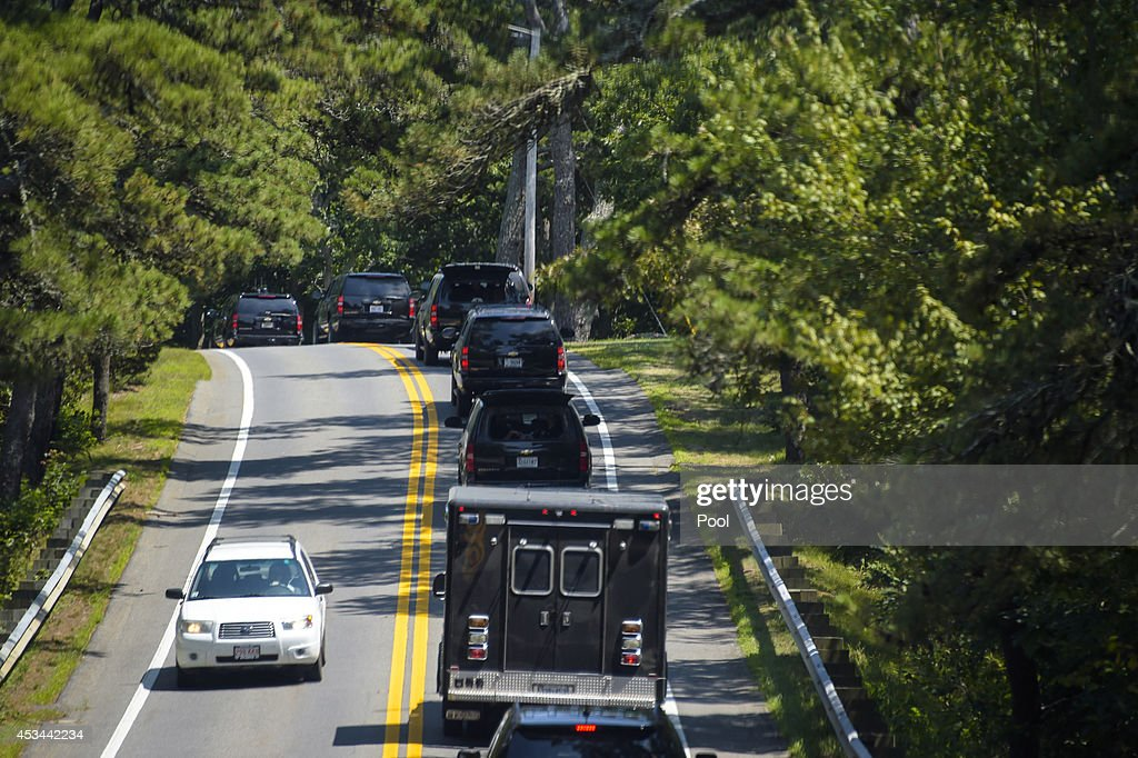 U.S. President Barack Obama's motorcade travels down a road on route to Farm Neck golf course August 10, 2014 West Tisbury, Martha's Vineyard, Massachusetts. The president and his family are vacationing on the island for two weeks.