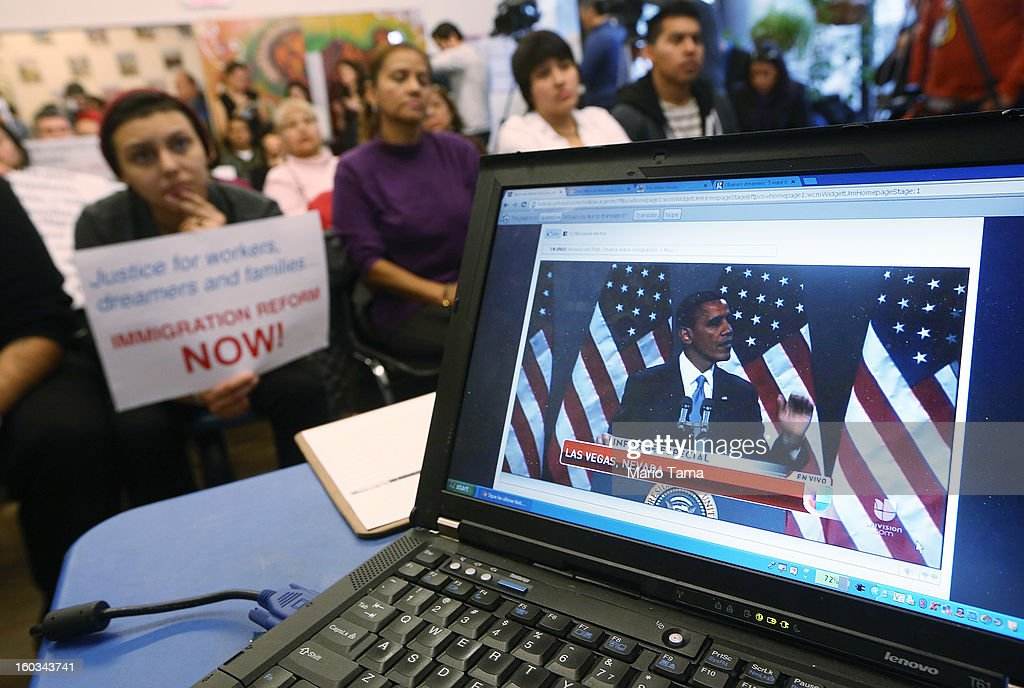 U.S. President Barack Obama's speech on immigration is played on a computer screen during a watch party held by an immigrant rights group on January 29, 2013 in the Queens borough of New York City. Obama called for immigration reform and a 'pathway to citizenship' for the nation's 11 million undocumented immigrants.