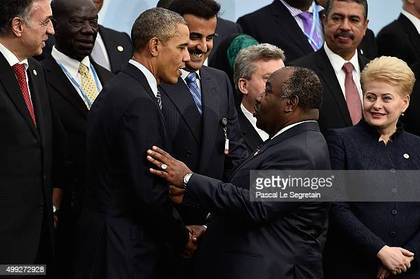 President Barak Obama shakes hads with President of Congo Ali Bongo Ondimba during the family photo session of the Cop 21 on November 30 2015 in...