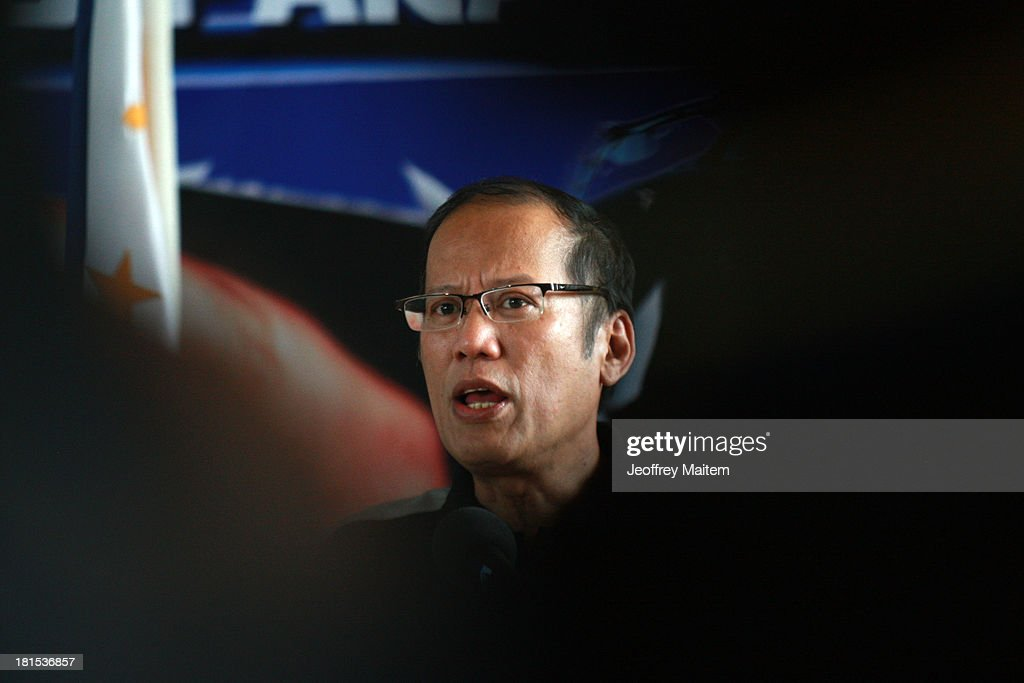 President Benigno Aquino III answers question from the media minutes before he departs for Manila from Zamboanga, Philippines as the fighting involving soldiers and Muslim rebels subsides on September 22, 2013. Rebellion and violation of international humanitarian laws have been filed against rebel chieftain Nur Misuari, the leader and founder of the Moro National Liberation Front, his top aide, Habier Malik and undetermined number of John Does and Jane Does who remain at large. The President said the military and police will continue to pursue the whereabouts of Misuari and Malik, believed to be still holding between 20 and 30 civilian hostages. The fighting that started September 9, 2013 came weeks after Misuari declared an independence of Mindanao. His group signed a peace accord with government in 1996.