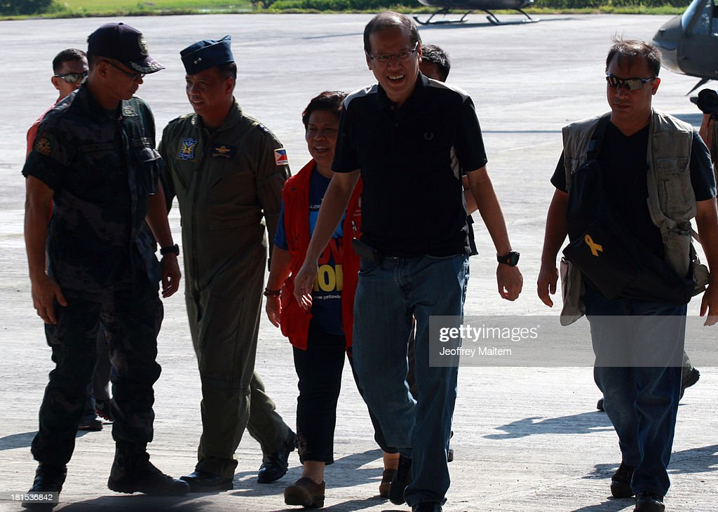 President Benigno Aquino III is seen with Secretary Dinky Soliman of Department of Social Welfare and Development minutes before he departs for Manila from Zamboanga, Philippines as the fighting involving soldiers and Muslim rebels subsides on September 22, 2013. Rebellion and violation of international humanitarian laws have been filed against rebel chieftain Nur Misuari, the leader and founder of the Moro National Liberation Front, his top aide, Habier Malik and undetermined number of John Does and Jane Does who remain at large. The President said the military and police will continue to pursue the whereabouts of Misuari and Malik, believed to be still holding between 20 and 30 civilian hostages. The fighting that started September 9, 2013 came weeks after Misuari declared an independence of Mindanao. His group signed a peace accord with government in 1996.