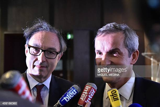 AFA president Bernard Spitz and deputy president Pascal Demurger answer journalists after a press conference to present the new 'econstat'...