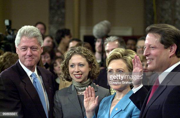 President Bill Clinton and Chelsea look on as Freashmen Senator Hillary Clinton is sworn in by Vice President Al Gore in the old Senate Chamber