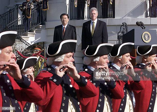President Bill Clinton and Chinese Premier Zhu Rongji watch ceremonial troops on the south lawn of the White House 08 April 1999 during a state...