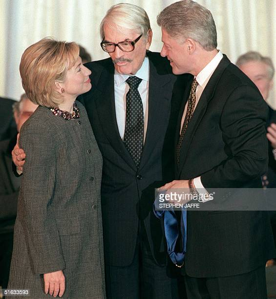 President Bill Clinton and First Lady Hillary Clinton are embraced by US actor Gregory Peck during the presentation of the National Medal of Arts...