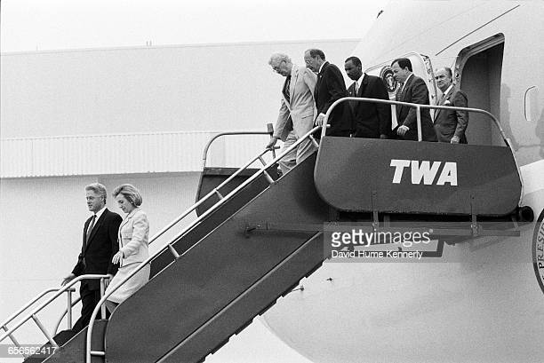 President Bill Clinton and First Lady Hillary Clinton arrive aboard Air Force One at JFK International Airport for a briefing and press conference...