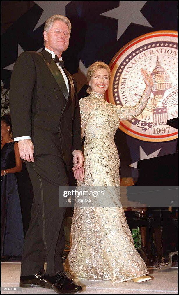 President Bill Clinton and First Lady Hillary Clinton wave as they arrive at an inaugural ball at the Old Post Office Pavilion 20 January in...