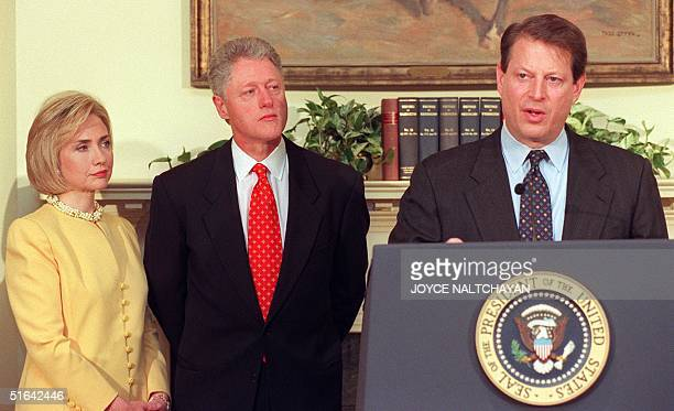 President Bill Clinton and his wife Hillary listen as US Vice President Al Gore speaks 26 January during an education event at the White House in...