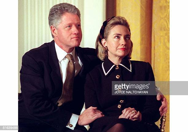 President Bill Clinton and his wife Hillary listen to speakers at a Coalition for America's Children event at the White House in Washington DC 03...