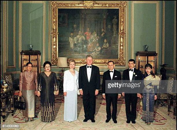 US President Bill Clinton and his wife Hillary pose with the Thai royal family under the portrait of the king's grandfather King Chulalongkorn at the...