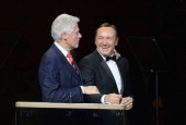 President Bill Clinton and Kevin Spacey speak during the 25th Anniversary Rainforest Fund Benefit Concert at Carnegie Hall on April 17 2014 in New...