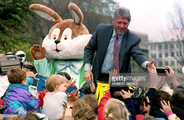 S President Bill Clinton and the Easter bunny greet children on the South Lawn of the White House 12 April 1993 during the annual Easter egg hunt...