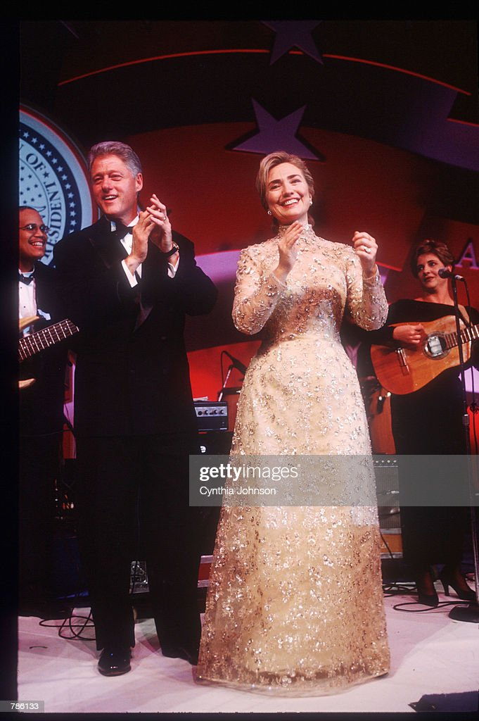President Bill Clinton and wife Hillary clap their hands at an inaugural ball January 20 1997 in Washington DC Clinton attended various inaugural...