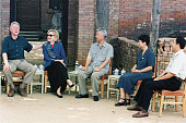President Bill Clinton and wife Hillary Rodham Clinton share a laugh with people while visiting a village in China's Shaanxi Province | Location near...