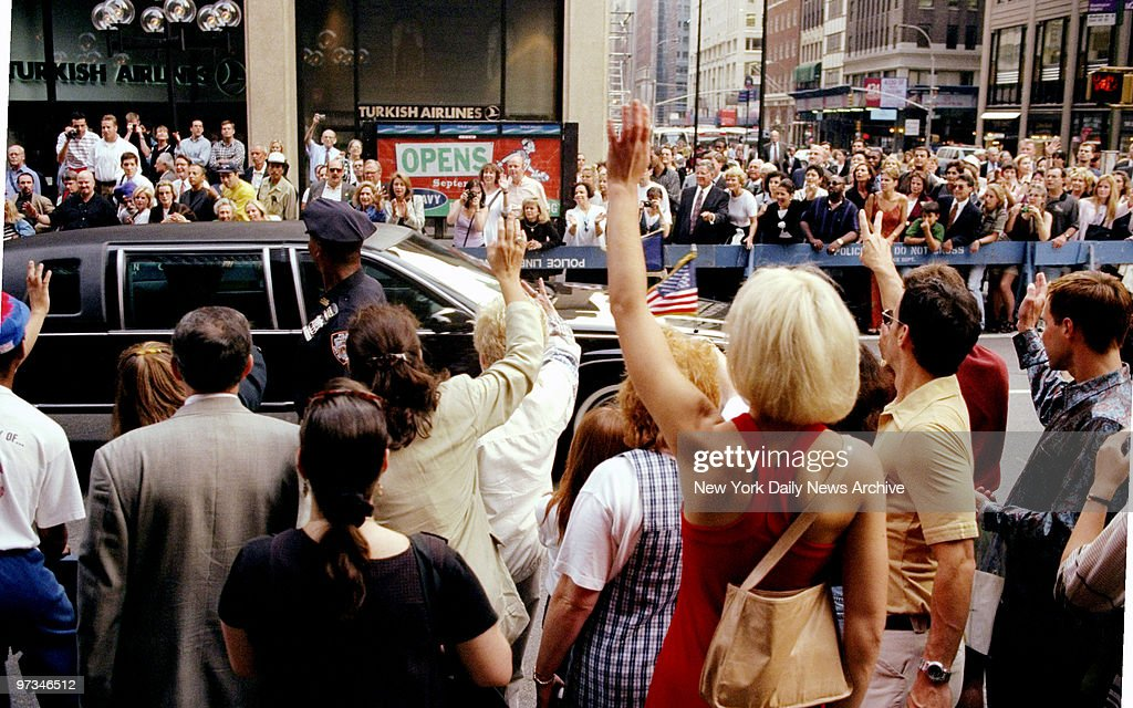 President Bill Clinton at the Waldorf Astoria 50th St and Park Ave Crowd waving to President as motorcade passes at 50th St and Fifth Ave