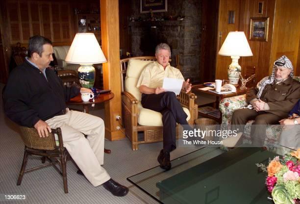 S President Bill Clinton center speaks during a morning meeting with Israeli Prime Minister Ehud Barak left and Palestinian Chairman Yasser Arafat...