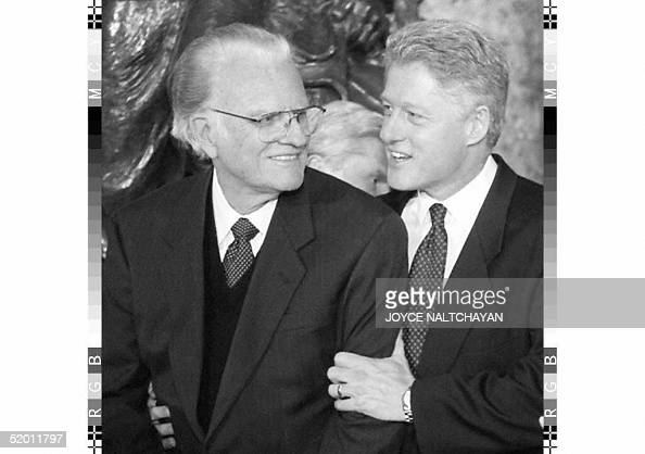 President Bill Clinton embraces Reverend Billy Graham 20 January during the inaugural luncheon at the US Capitol in Washington DC Earlier 20 January...