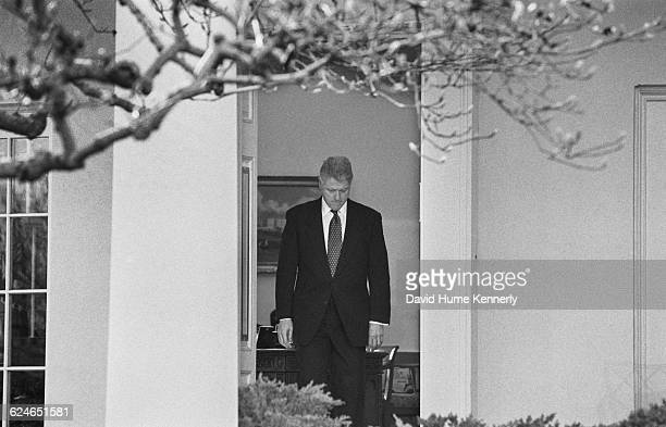 President Bill Clinton emerges from the Oval Office to talk to the media after learning that the US Senate voted to acquit him of the charges of...
