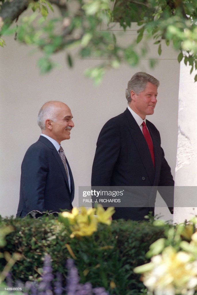 U.S. President Bill Clinton (R) escorts Jordan's King Hussein (L) through the colonnade at the White House in Washington, DC. on June 18, 1993. Clinton and Hussein held meetings to discuss U.S.-Jordanian relations.