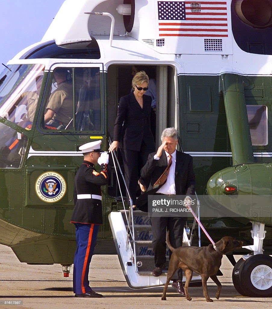 President Bill Clinton First Lady Hillary Clinton and their daughter Chelsea depart Marine One and go towards Air Force One with the family dog Buddy...