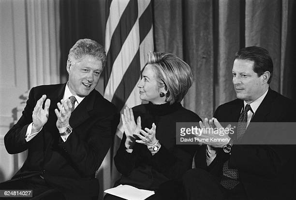 President Bill Clinton First Lady Hillary Clinton and Vice President Al Gore applaud at the Madison Commemorative Coin presentation on January 11...