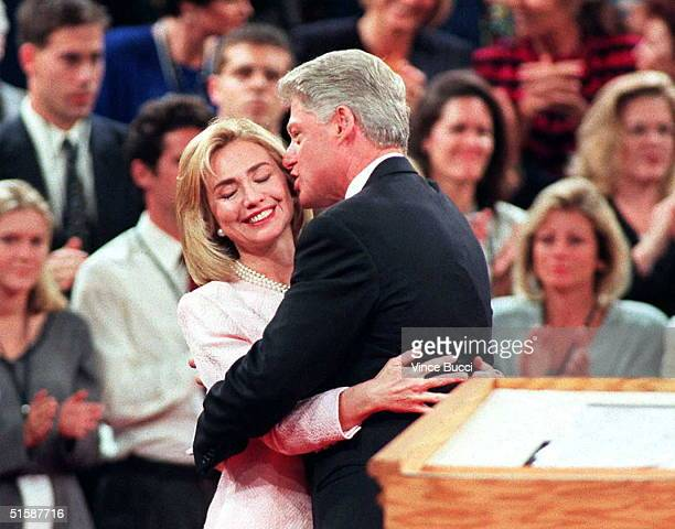President Bill Clinton gets a hug from his wife Hillary after the presidential debate 16 October at Shiley Theater at the University of San Diego in...