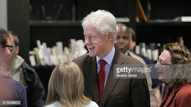 President Bill Clinton greets people inside the Newton Free Library a polling place in Newton Mass during Massachusetts primary voting on March 1 2016