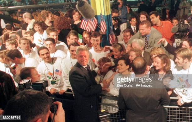 US President Bill Clinton greets workers from the Gateway 2000 factory in Clonshaugh near Dublin where he and Irish Taoiseach Bertie Ahern today...