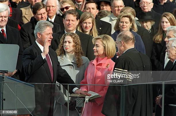 President Bill Clinton is sworn in 20 January 1997 on Capitol Hill in Washington DC for his second term as president of the United States by US...