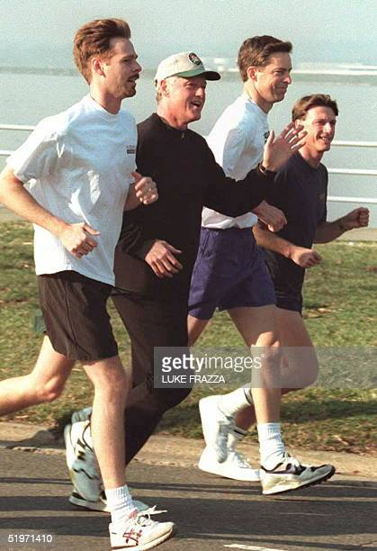 President Bill Clinton jogs with Mark Miller Clinton staff member and US Shuttle Astronauts James Wetherbee and Charles Foale 16 March at Haines...