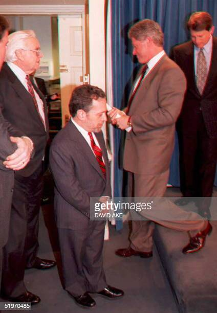 President Bill Clinton leaves the podium in the White House briefing room followed by Vice President Al Gore after announcing late 07 February that...