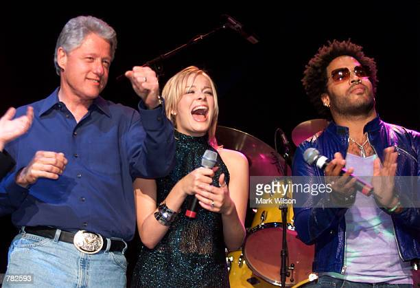 President Bill Clinton left LeAnn Rimes center and Lenny Kravitz laugh during a Democratic National Committee fundraiser honoring President Bill...