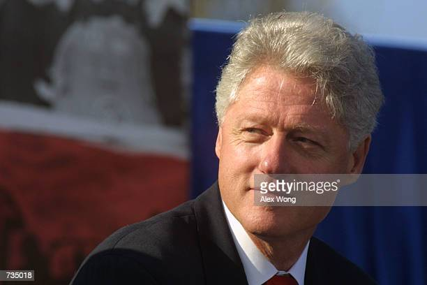 President Bill Clinton listens to speeches during the World War II Memorial Groundbreaking Ceremony on the National Mall November 11 in Washington